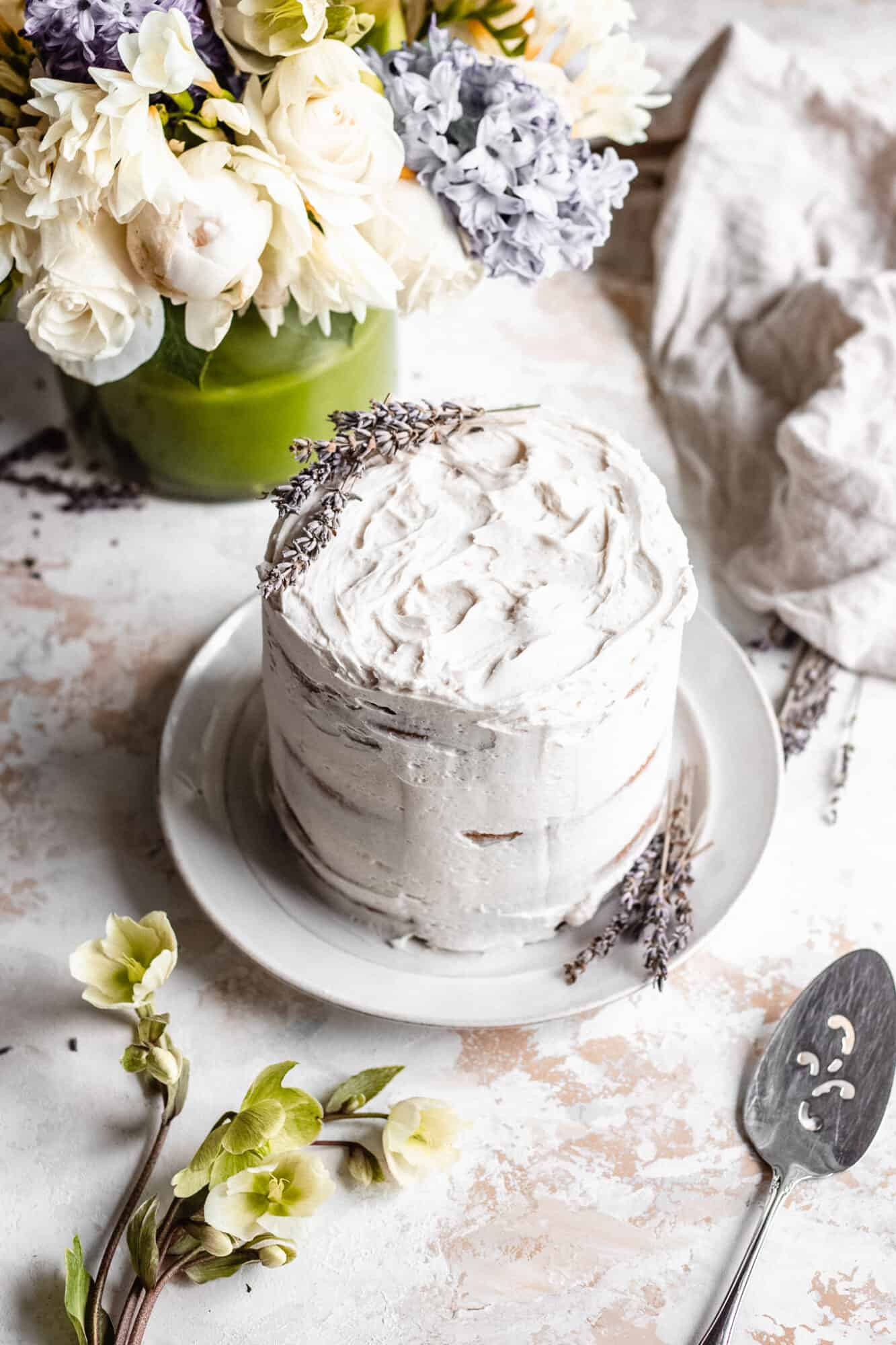 whole vegan vanilla cake with lavender on top