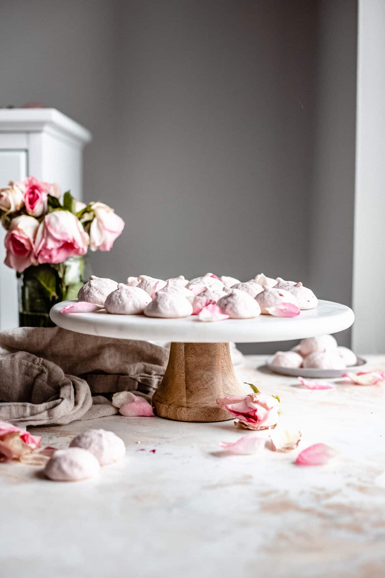 cake stand with meringue cookies on top