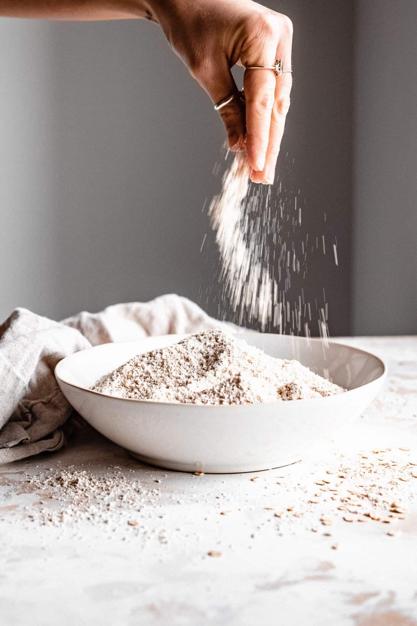 hand pinching oat flour