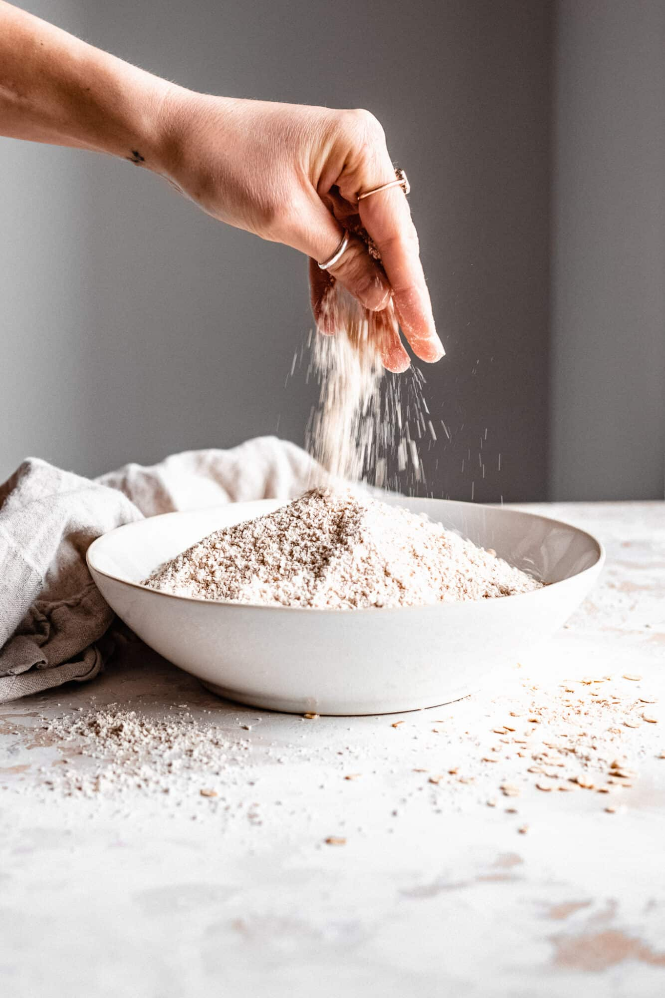 hand pinching flour