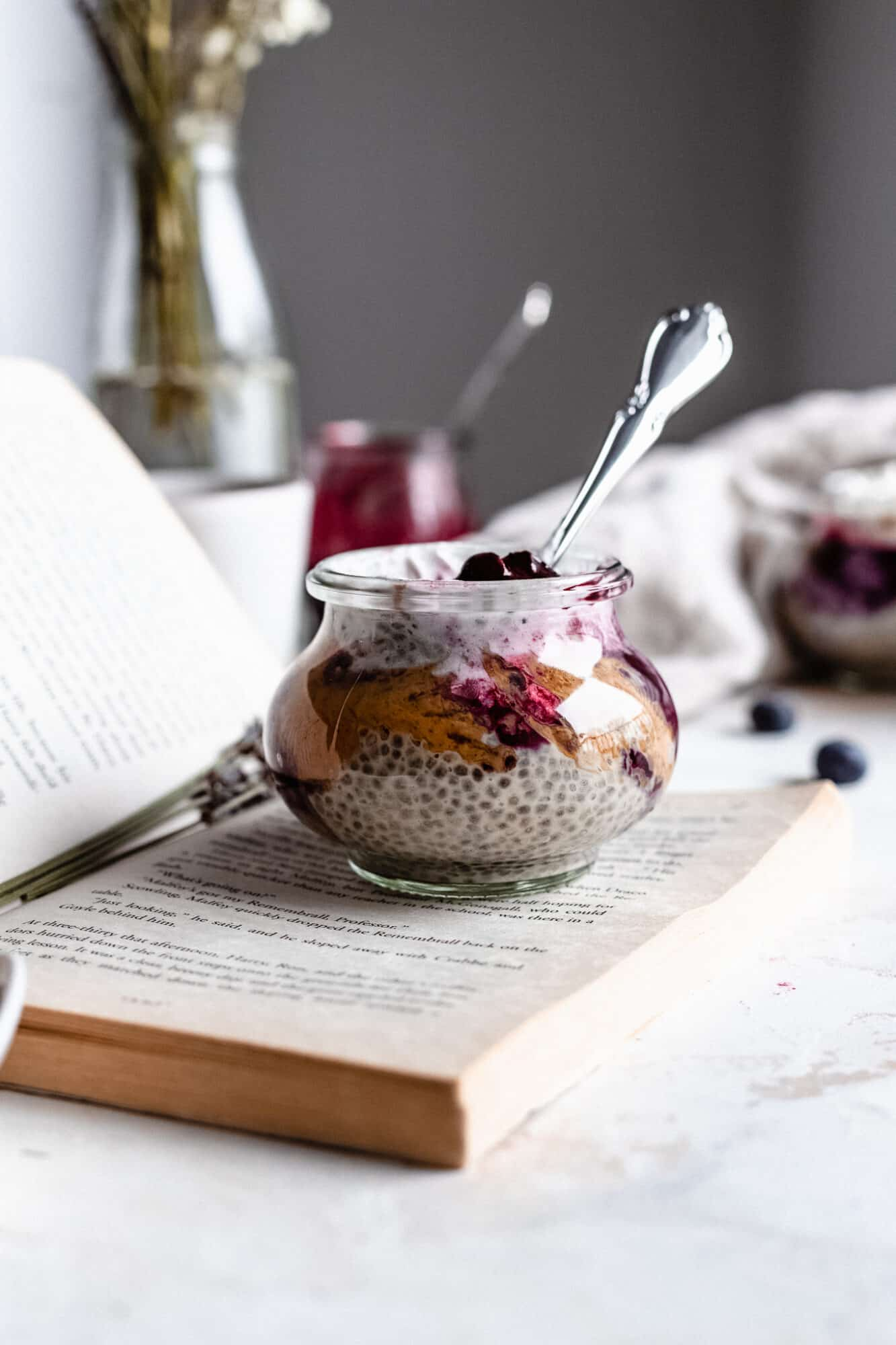 glass of keto chia pudding on book