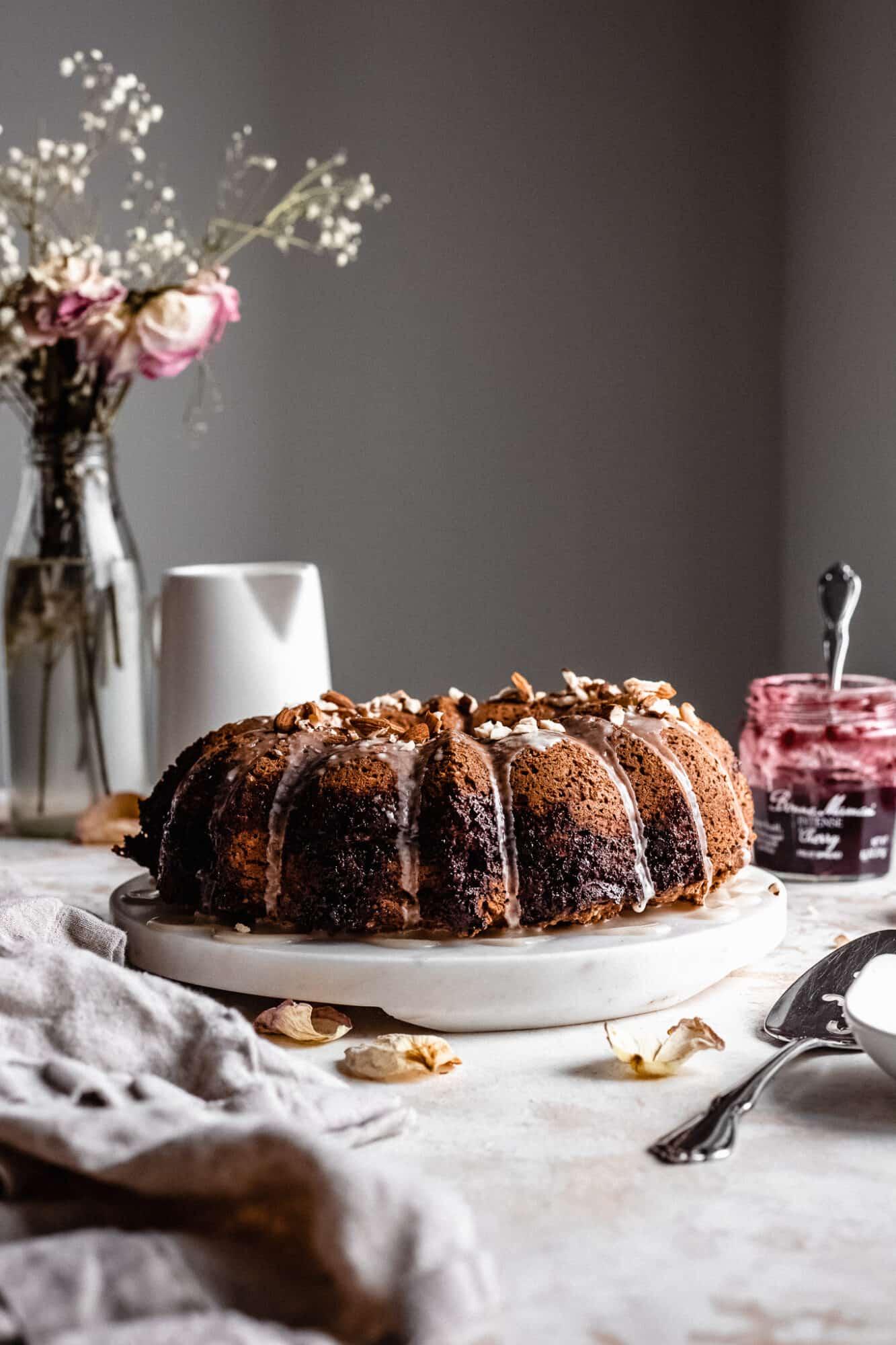 cherry almond bundt cake with jam jar