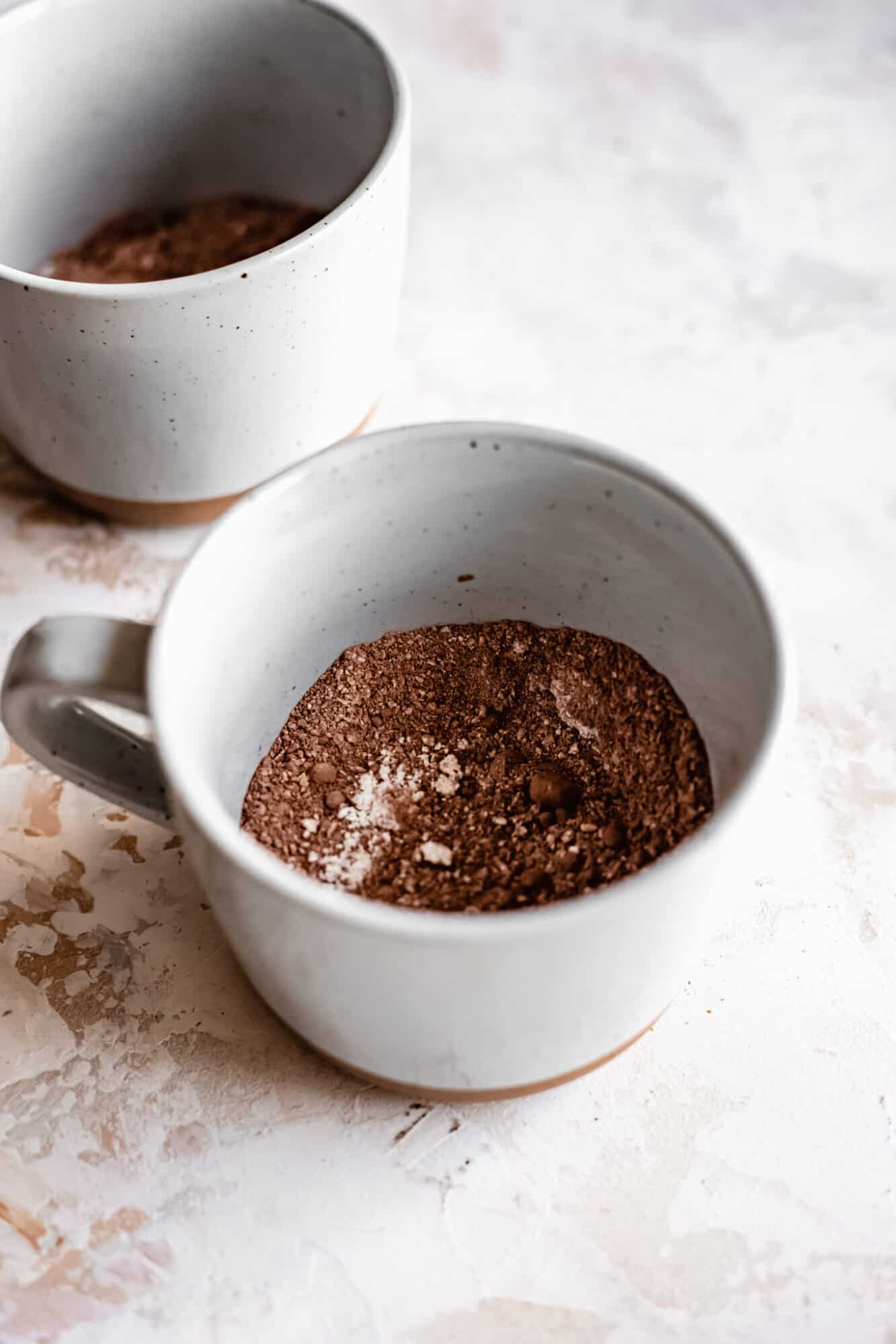 dry ingredients for healthy chocolate mug cake in mug