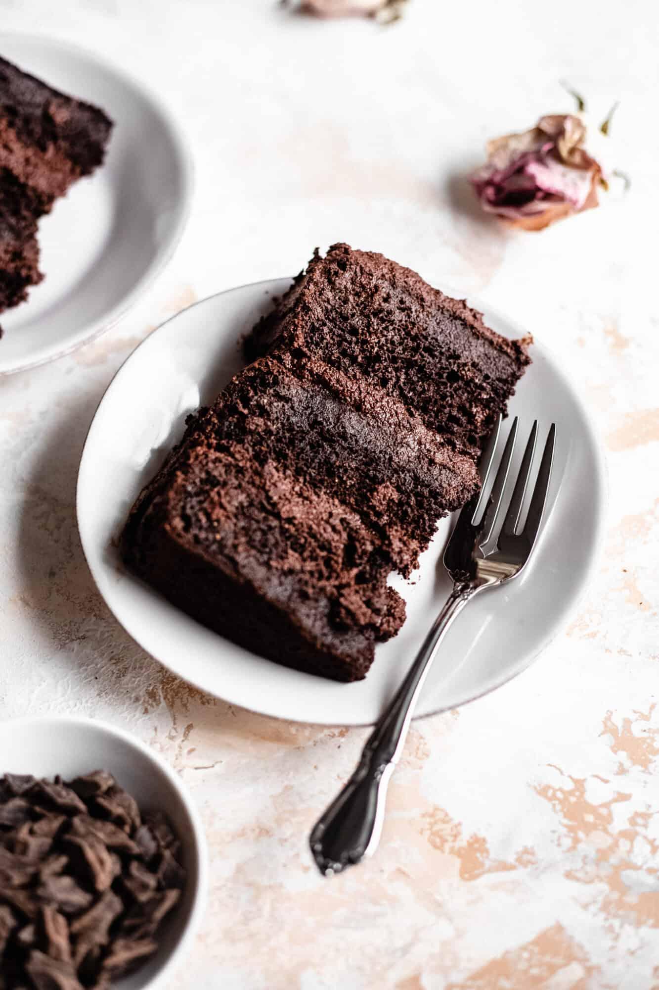 slice of gluten free vegan chocolate cake on a plate