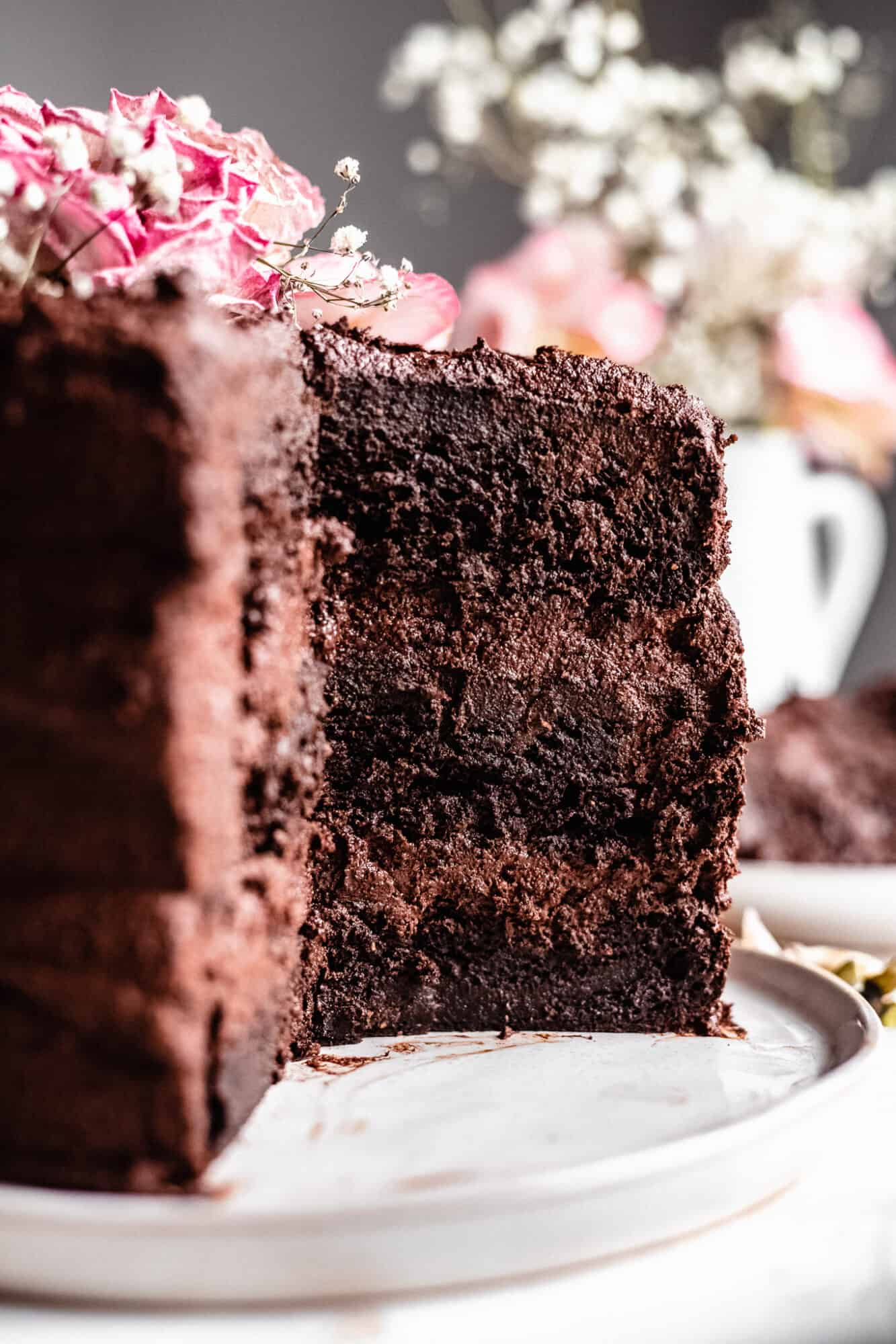 close up of three layer paleo chocolate cake