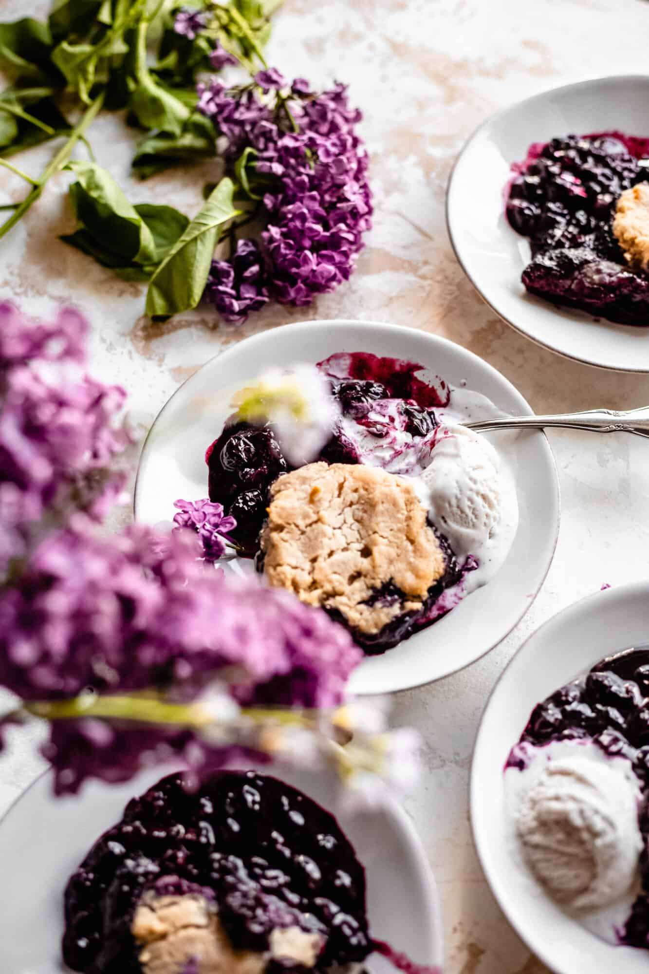 plates of blueberry cobbler