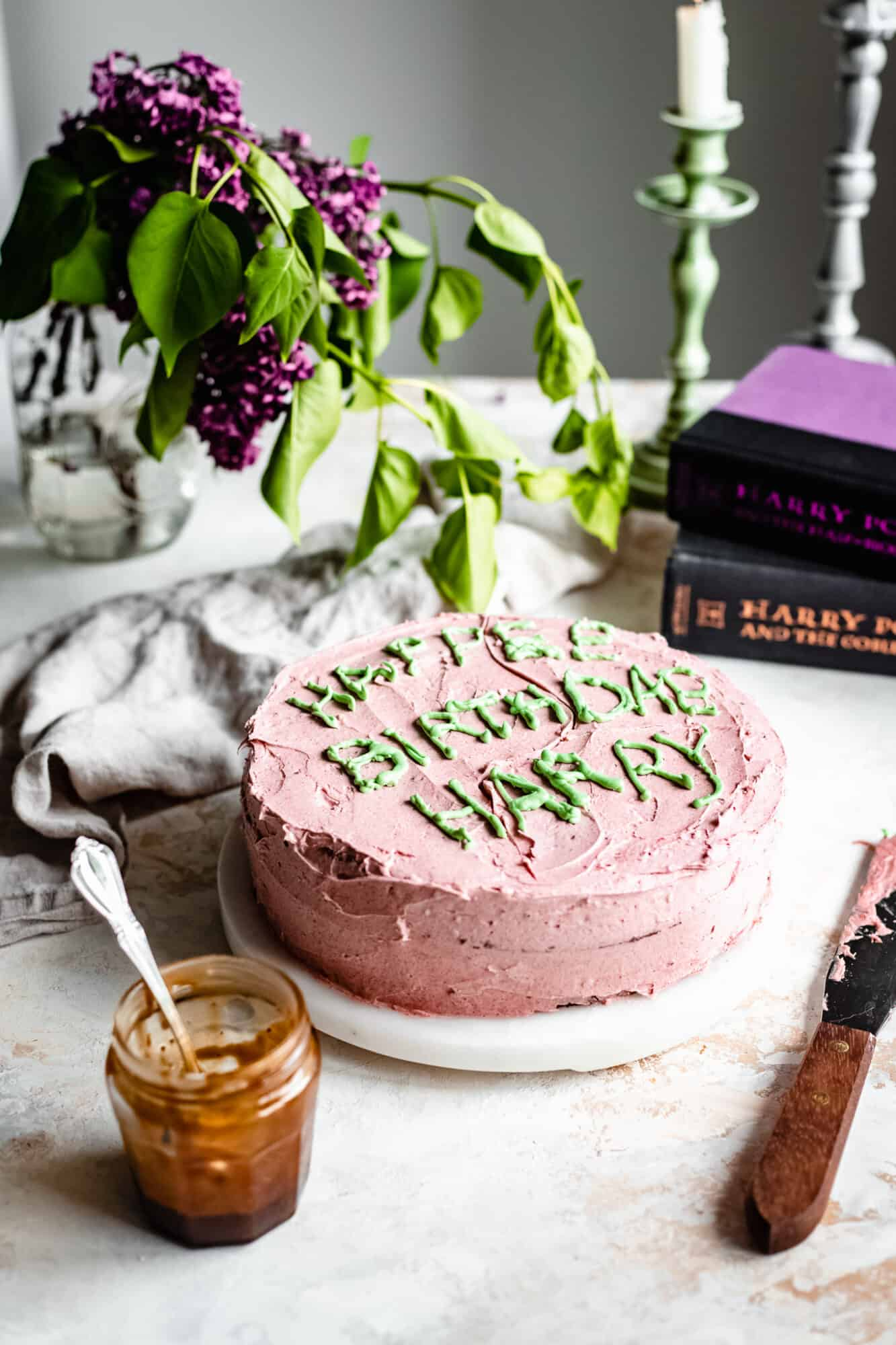 vegan harry potter cake with books next to it