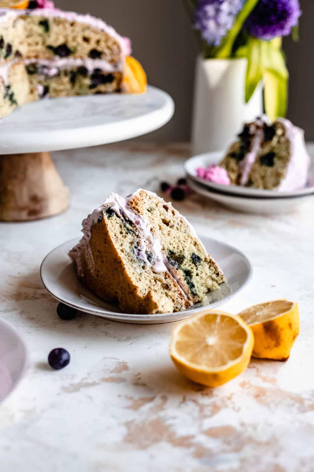 slice of cake with lemon next to it