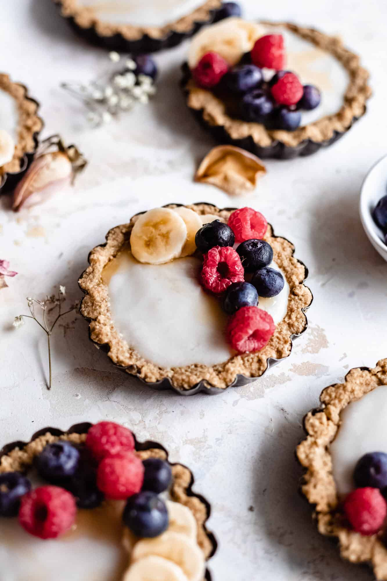 mini tarts with berries on top