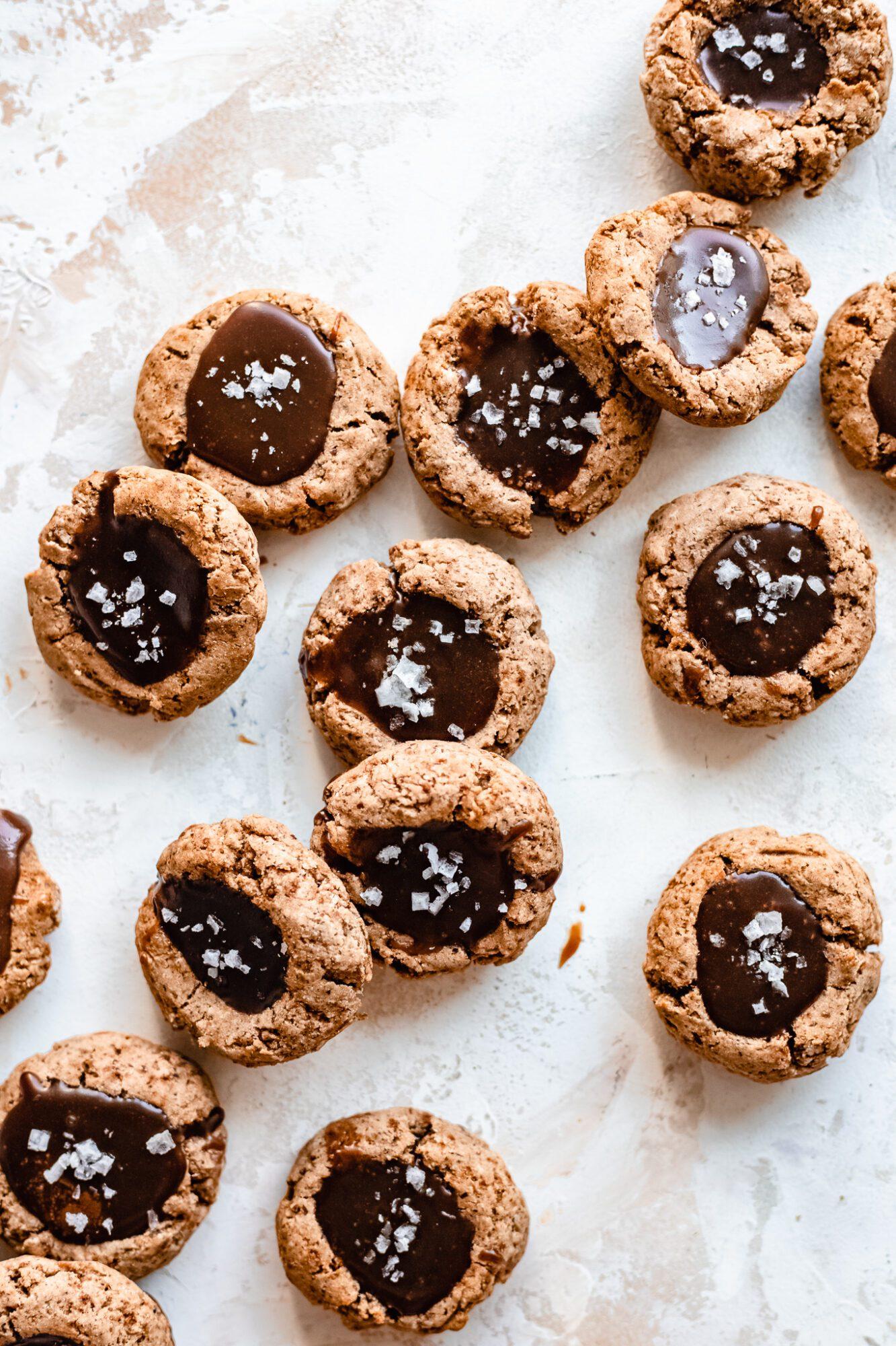 stacks of vegan caramel cookies with sea salt on top