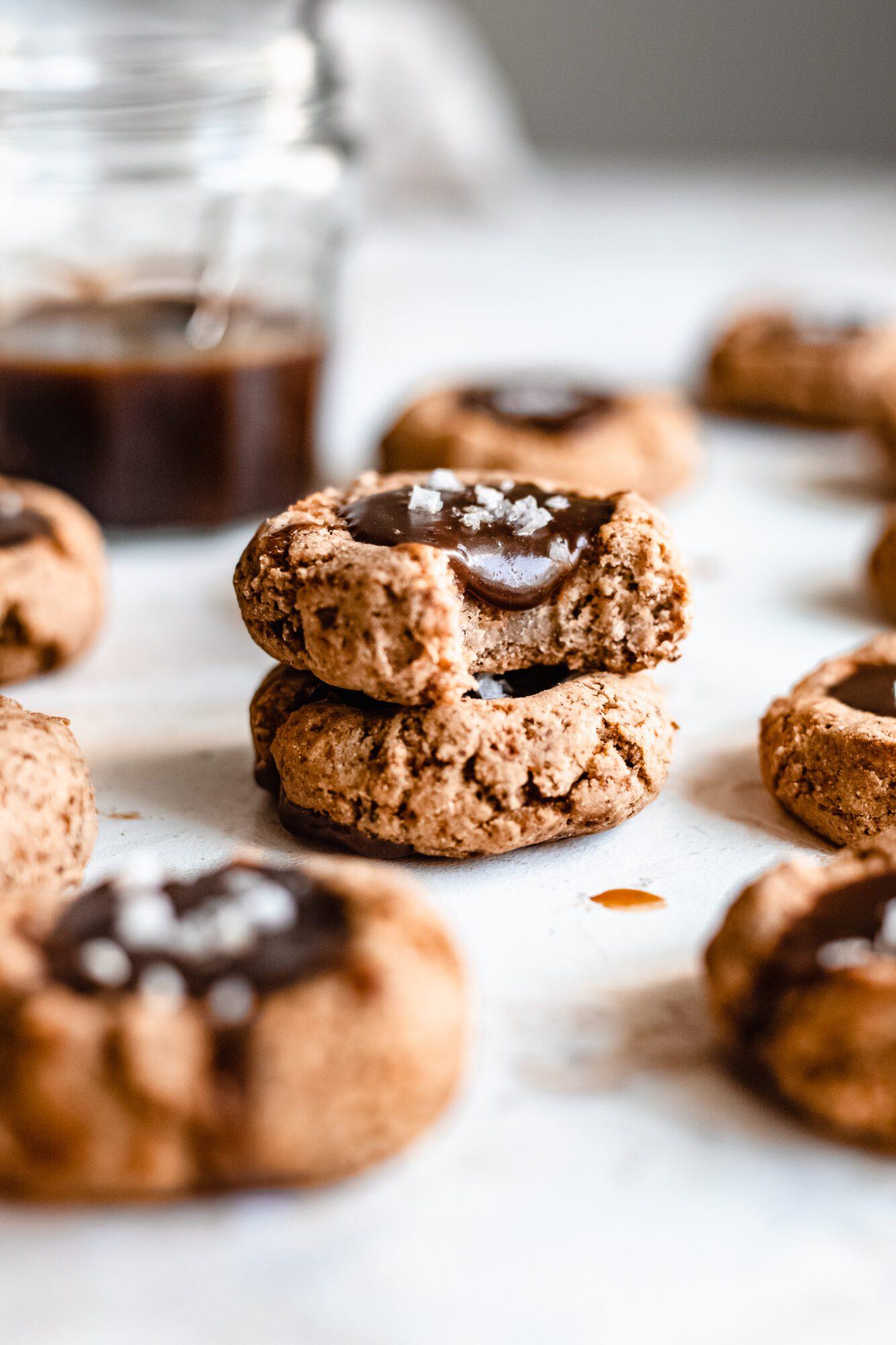 two vegan caramel thumbprint cookies stacked