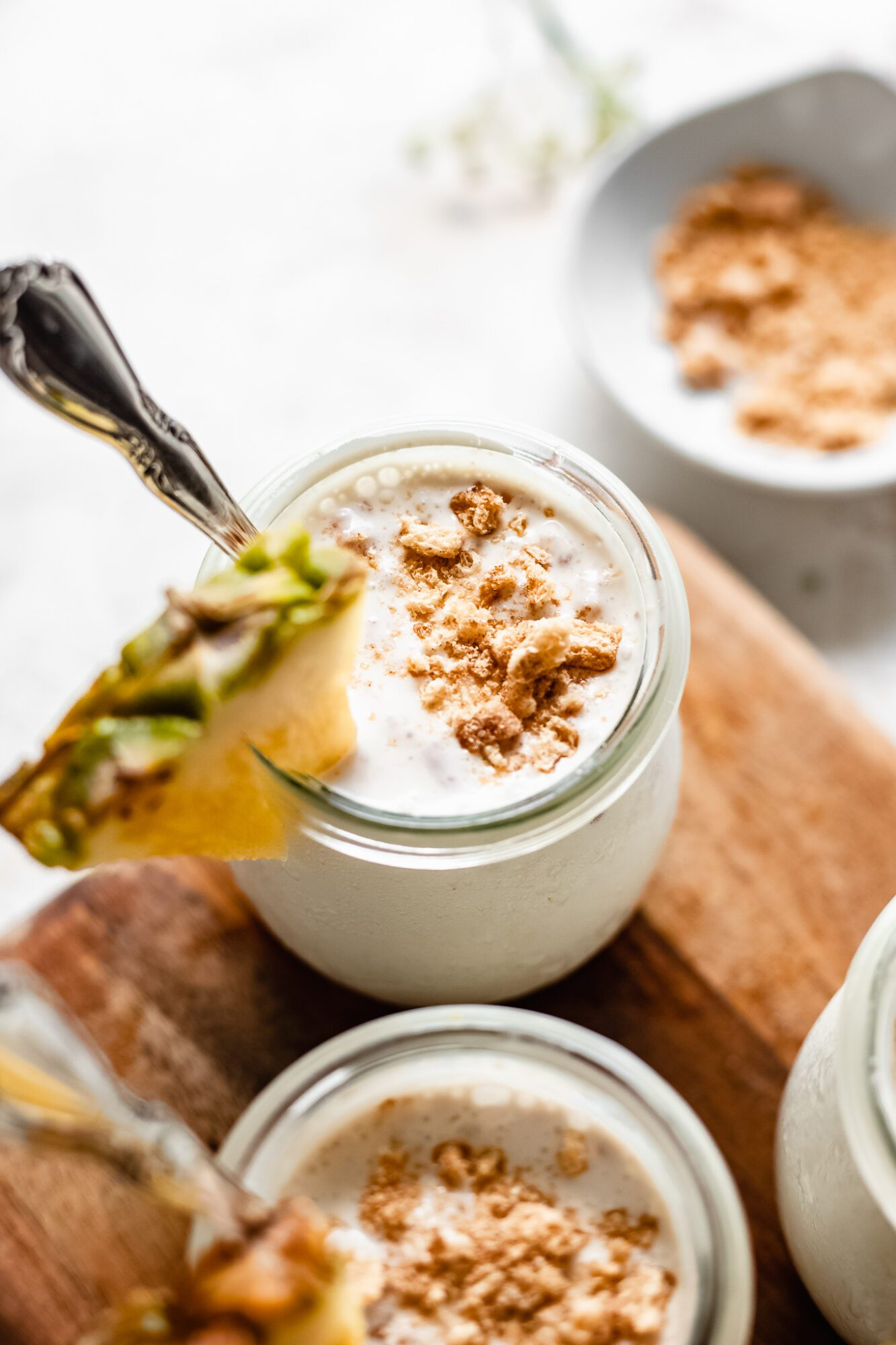 jars of pudding on wooden board