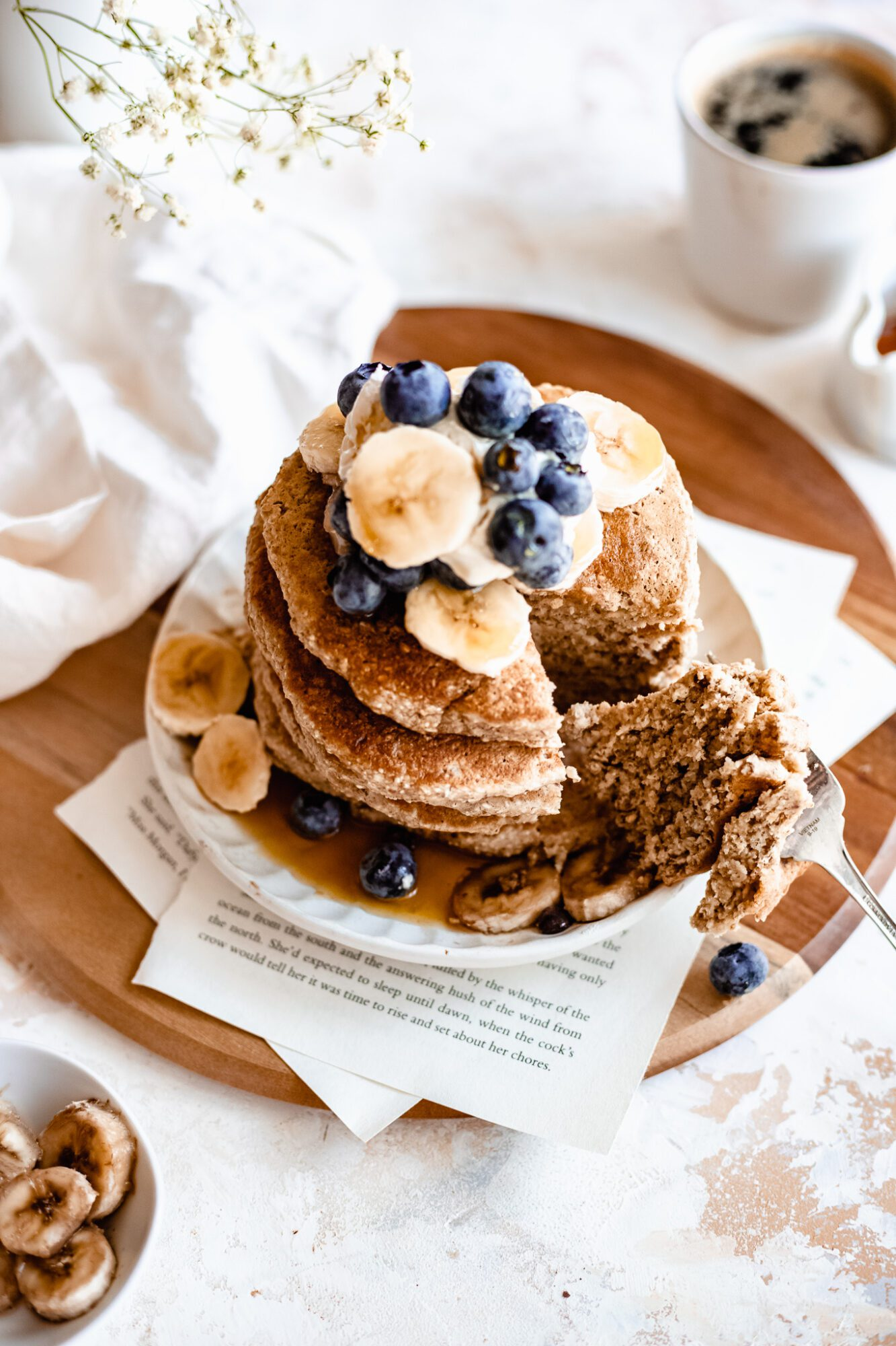 oatmeal pancakes on wooden board with slice missing