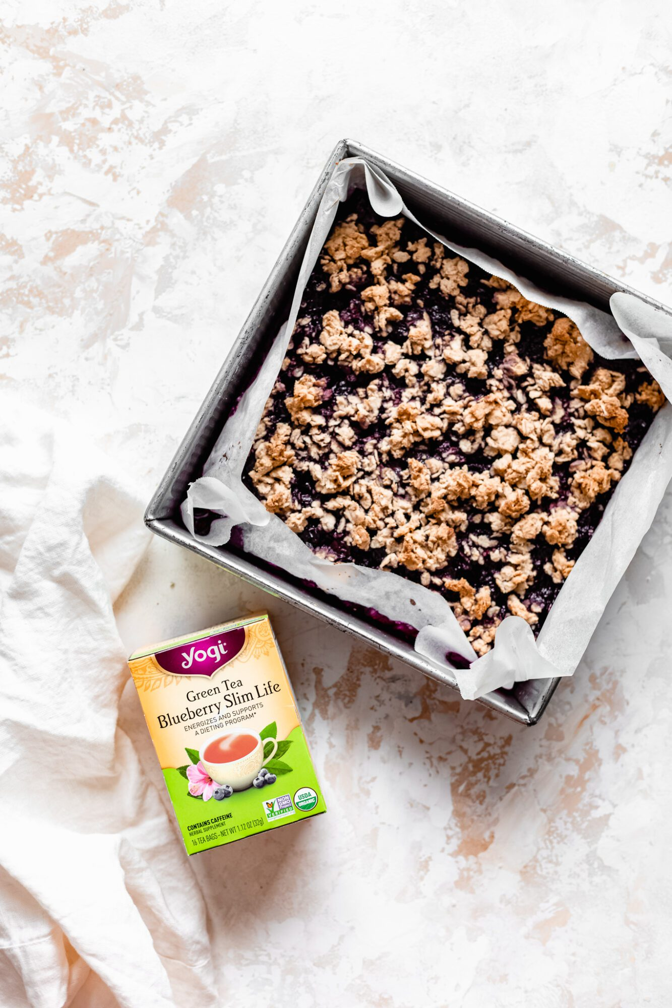 baked healthy blueberry crumble bars with yogi tea box