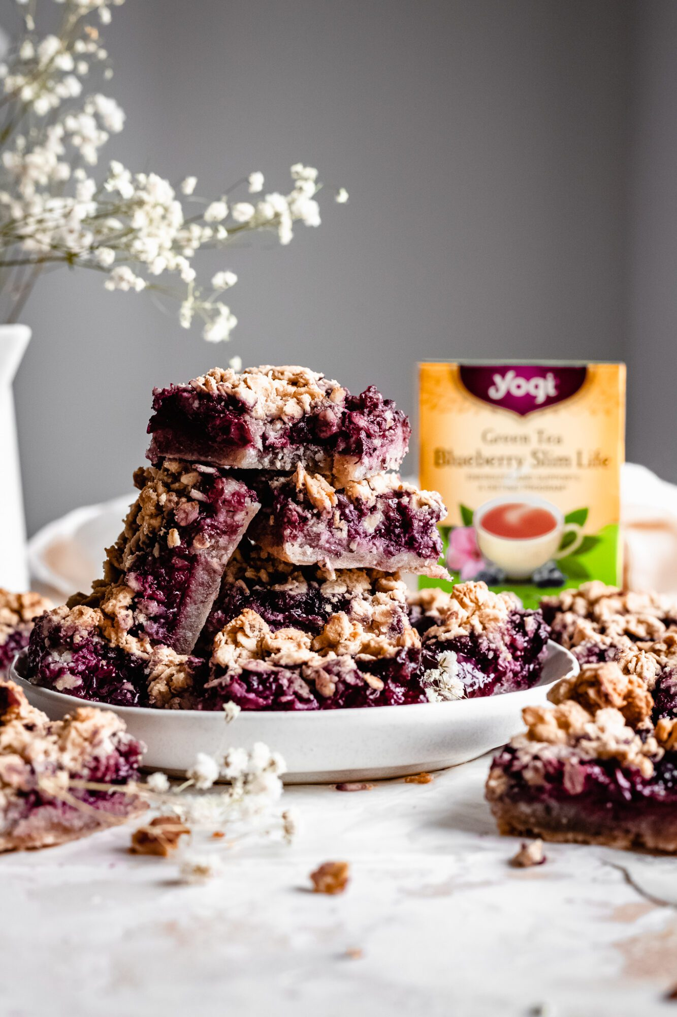 stacked vegan blueberry bars with yogi tea box in background