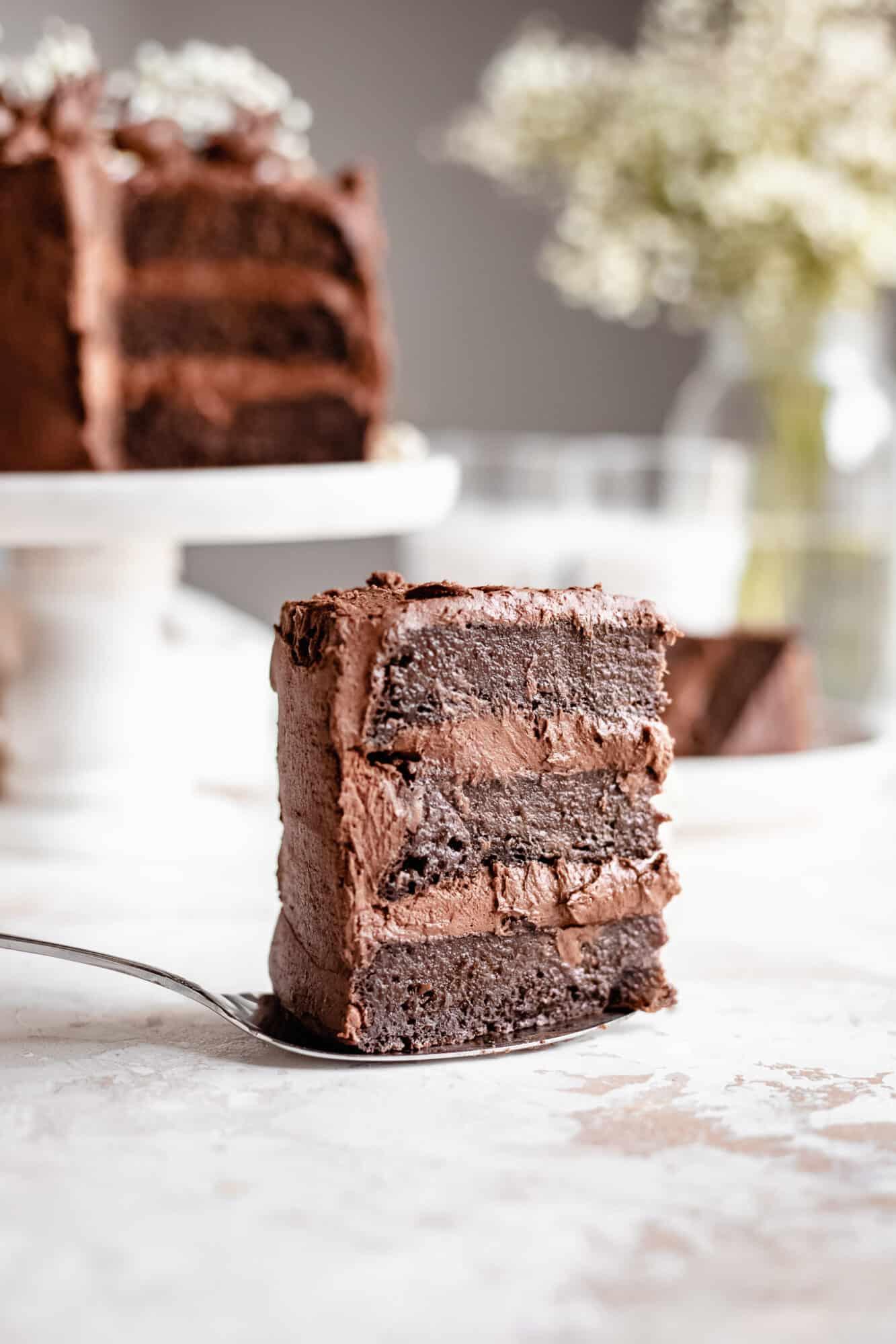 slice of layered vegan chocolate zucchini cake