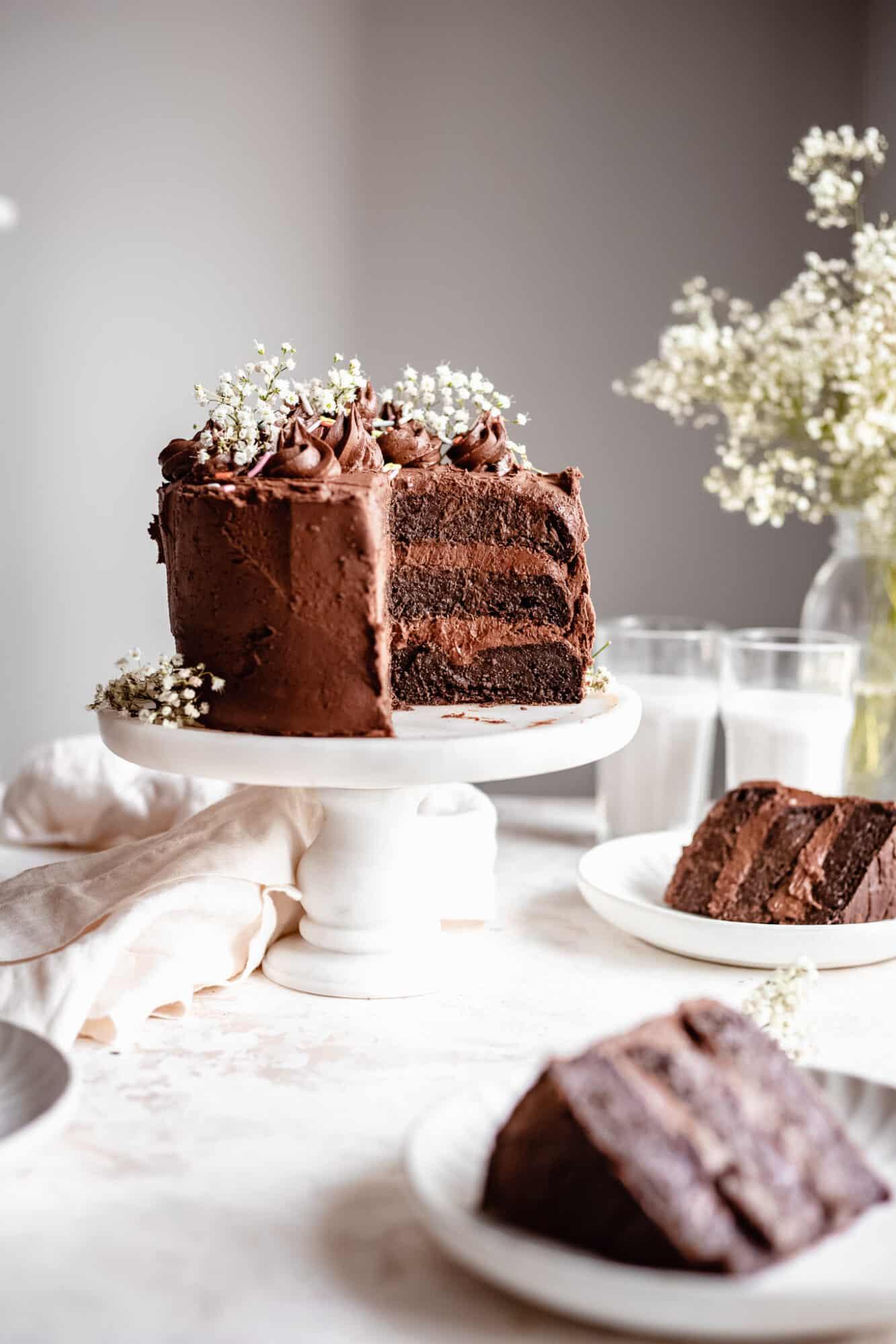slices of chocolate cake near zucchini cake