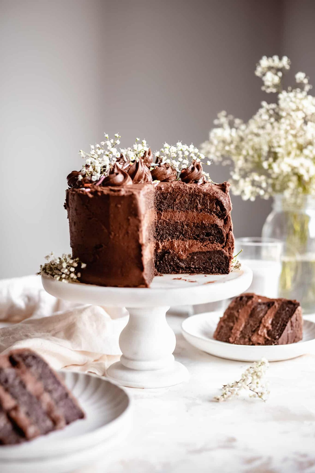 three tiered chocolate zucchini cake with slices
