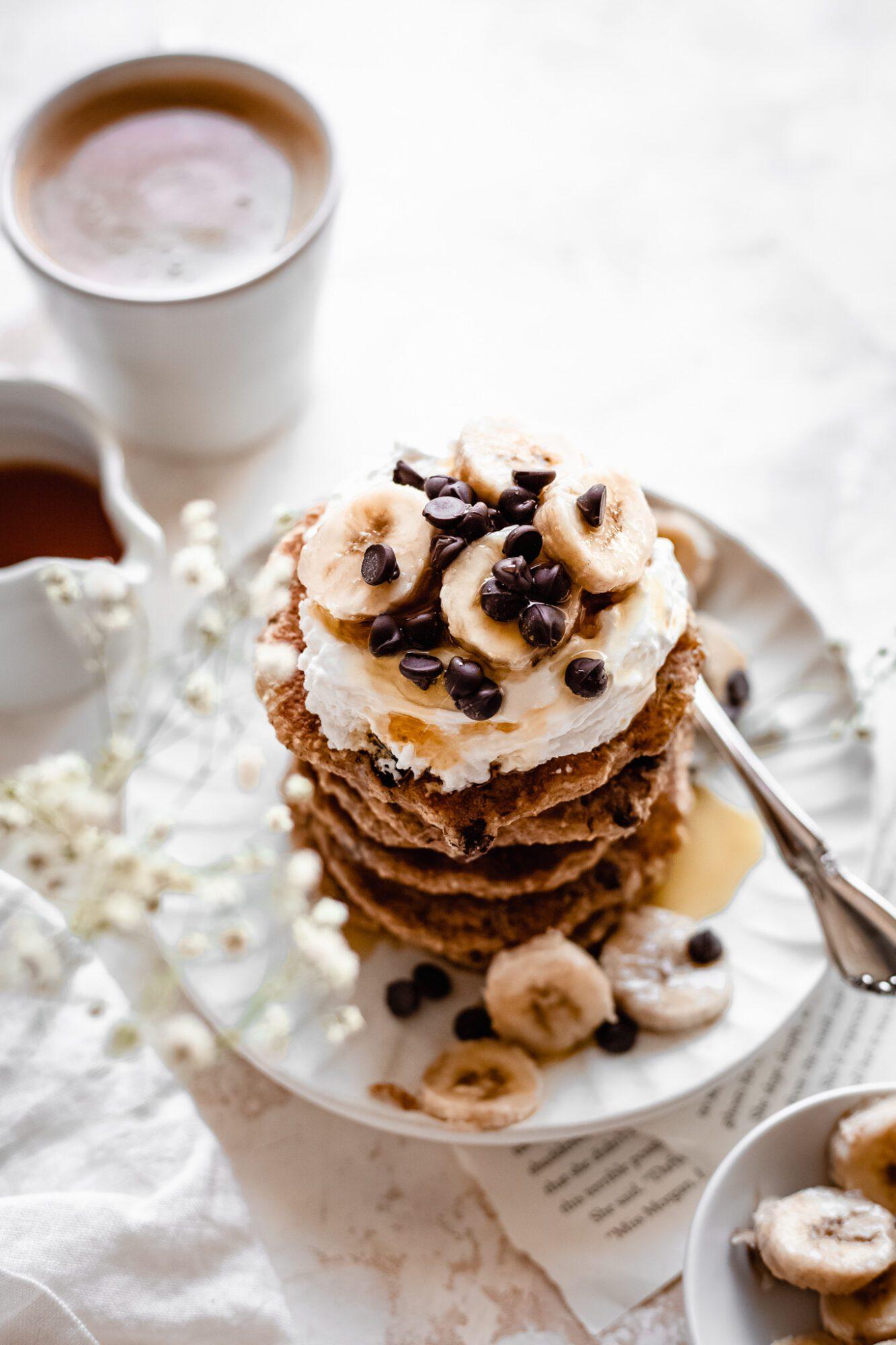 plate of vegan chocolate chip pancakes on white plate