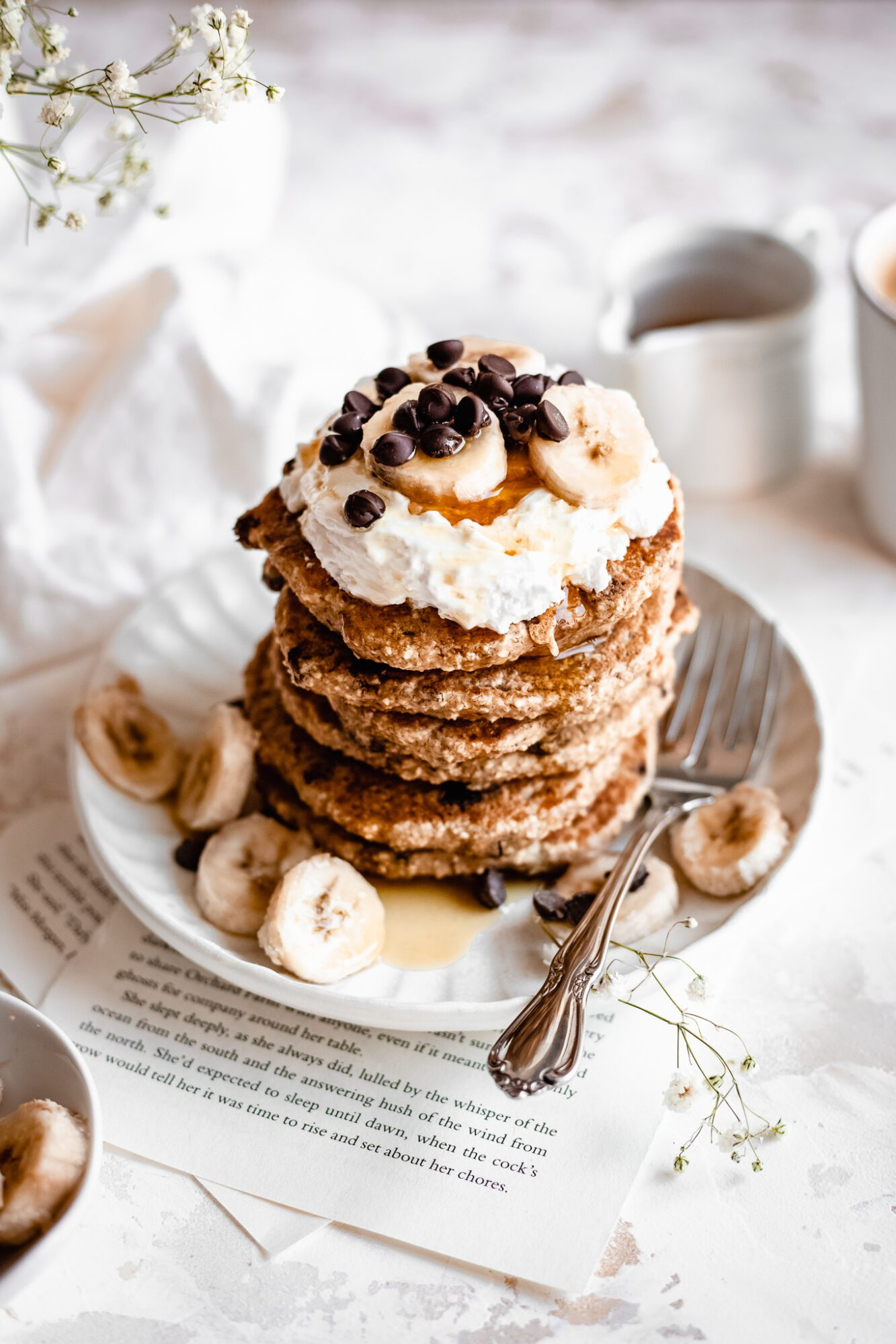 stack of vegan chocolate chip pancakes with maple syrup