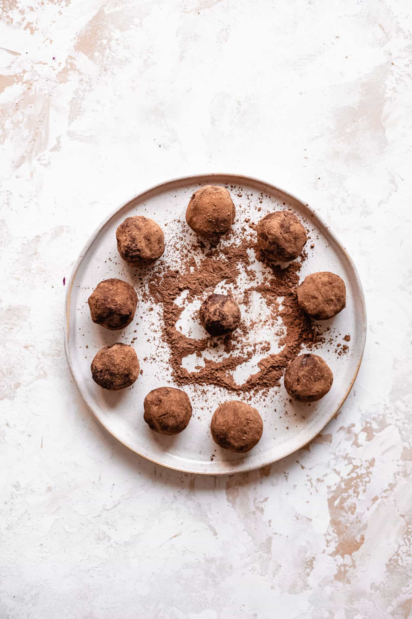 chocolate truffles rolled on plate