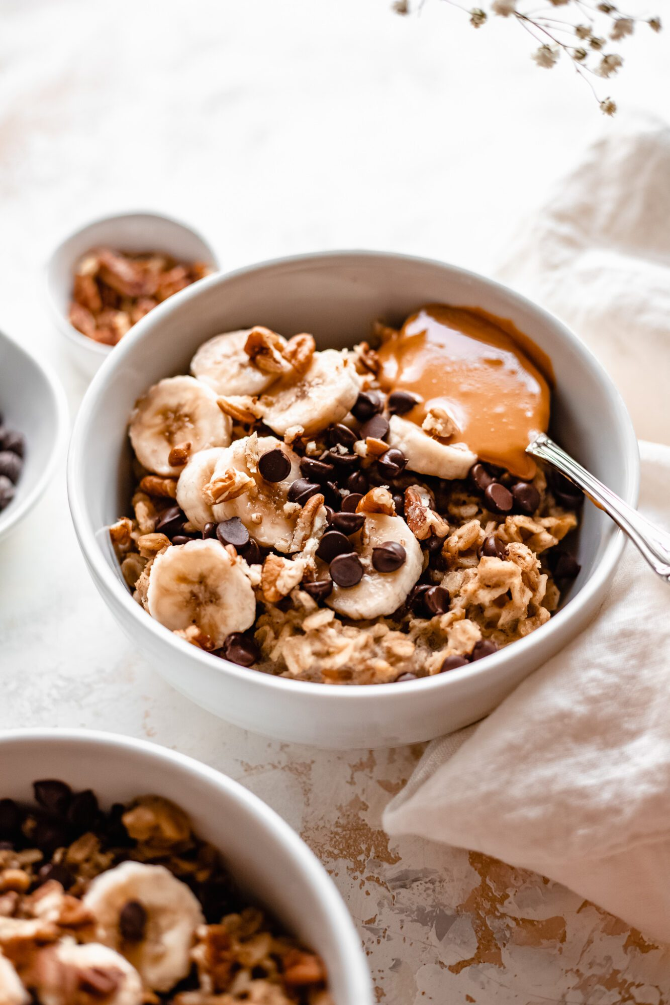 bowls of zucchini oatmeal with chocolate chips