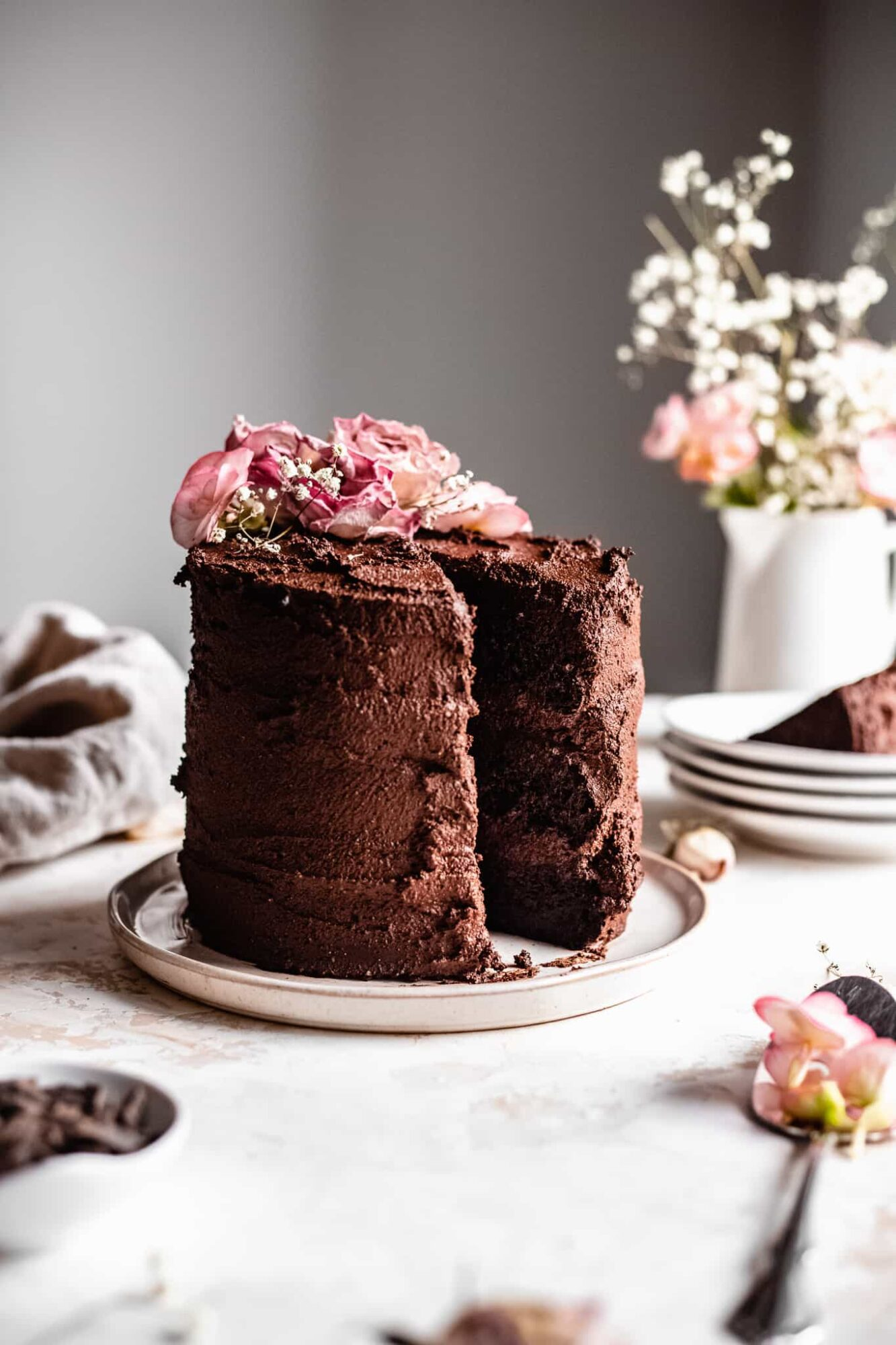whole chocolate cake with pink flowers