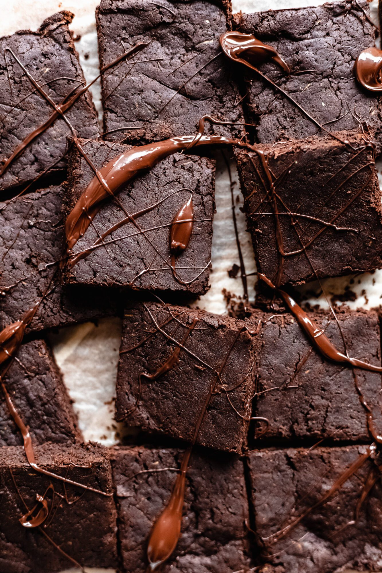 close up of healthy brownies drizzle in chocolate