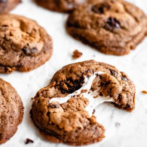 vegan chocolate chip cookie with marshmallow being pulled