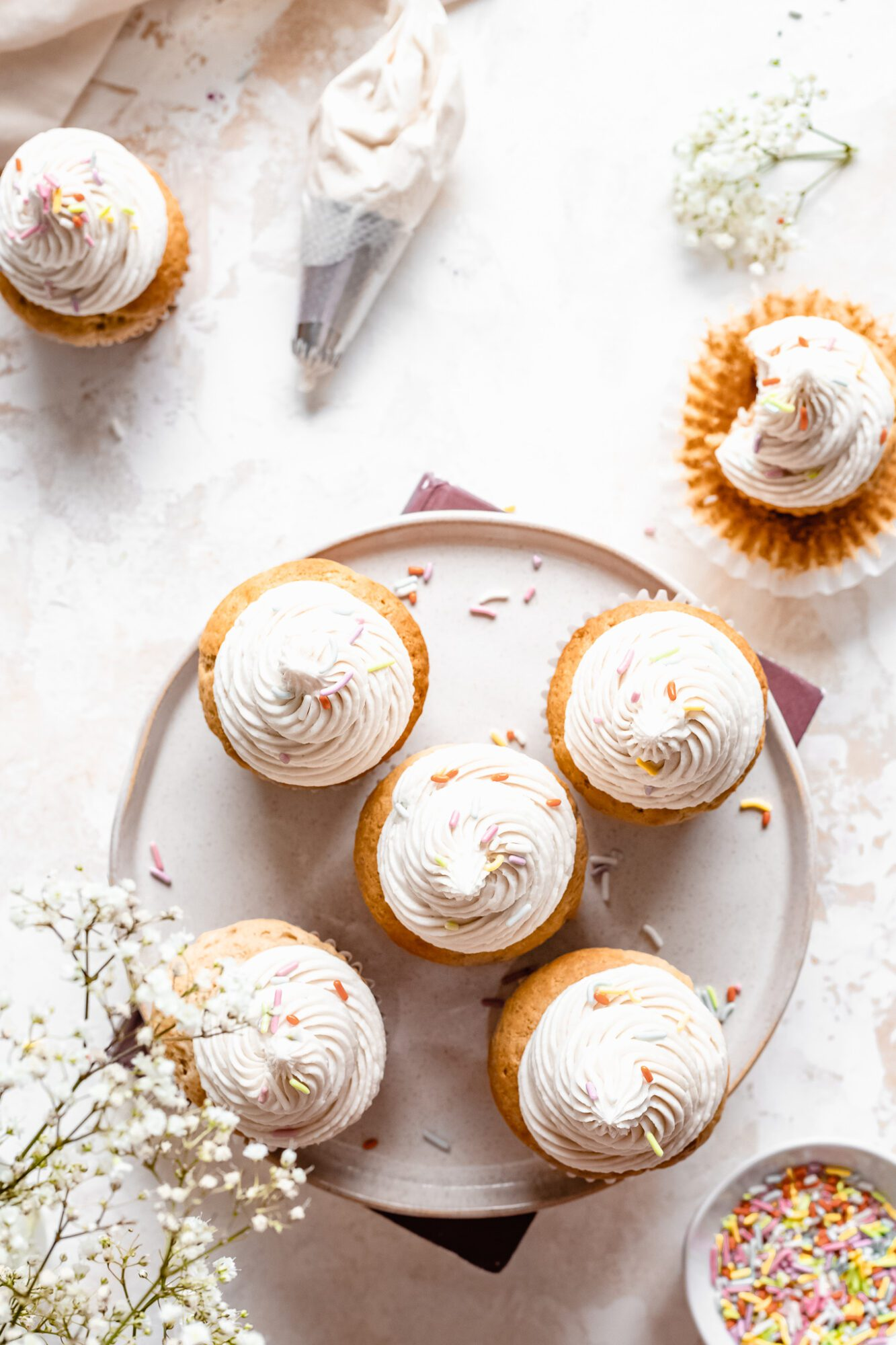 plate with gluten free vanilla cupcakes and frosting